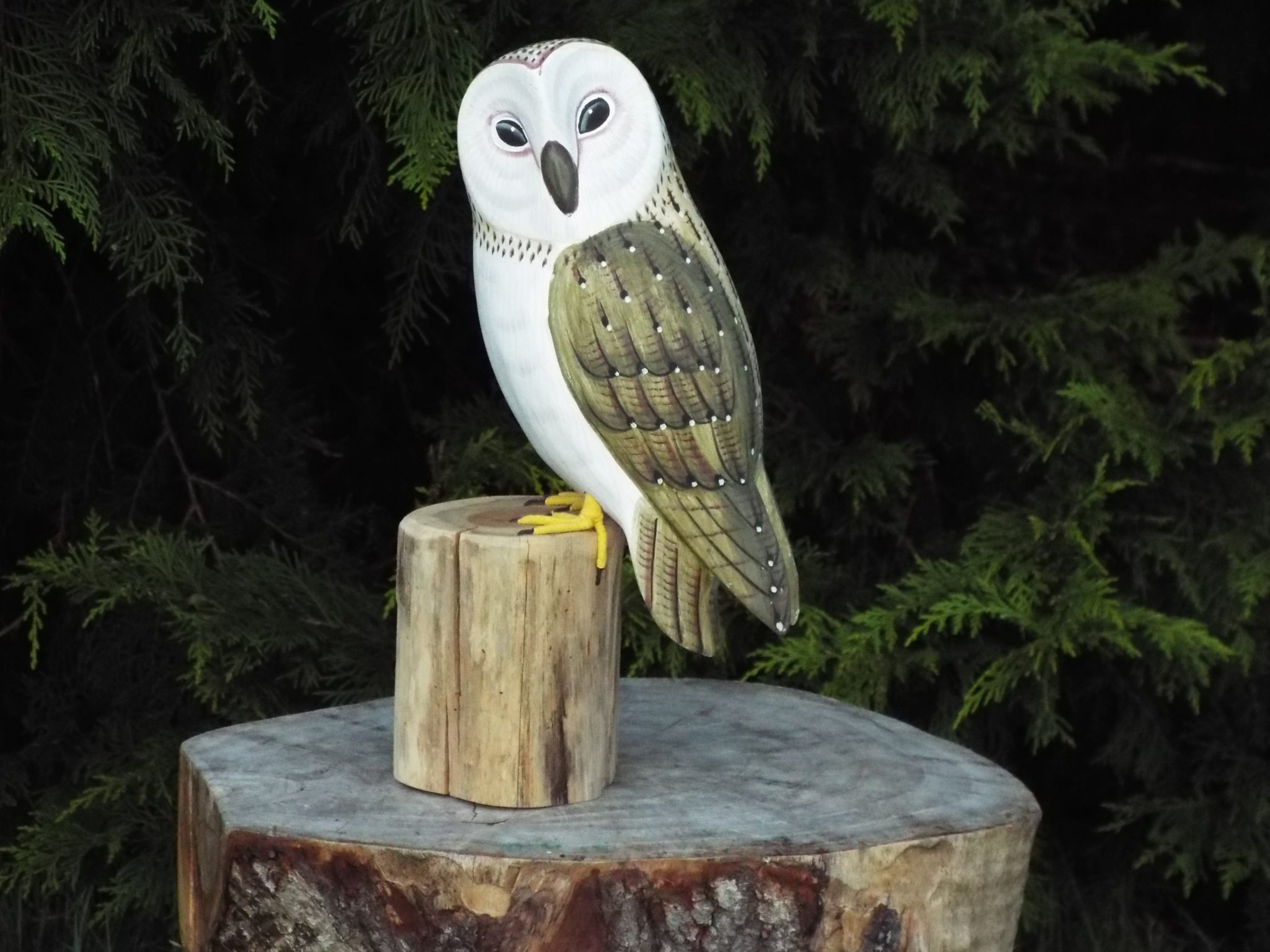 Chainsaw carving barn owl bird table in long eaton